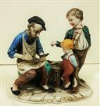 Cobbler with children in hand-painted ceramics