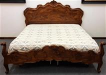Double bed in root of walnut, carved