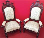 Pair of carved armchairs