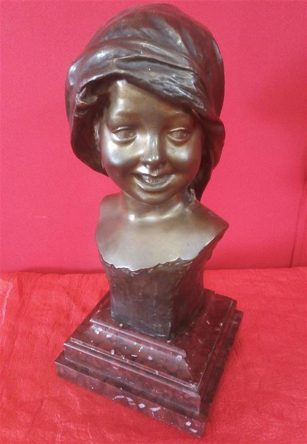 Smiling girl's face Bronze signed