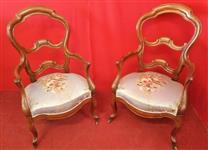Pair of armchairs with open backrest
