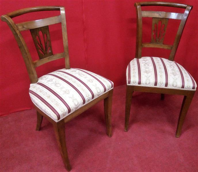 Pair of Carlo X chairs in walnut