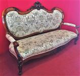 Large carved three-seater sofa